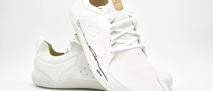 Benedict donates a pair of trainers to the Small Steps Project